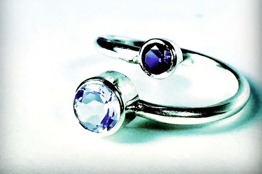 Jupiter and Io Ring, shown with blue sapphire and lavender quartz.