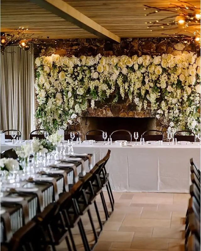 Take us back to this cosy indoor setup 💐 #boutiquebackdrops #wisteriaarch #nzweddings #aucklandweddings #waihekeweddings #receptionideas #bridaltable #nzbrideandgroom #backdrophire #aucklandflowerwall #nzflowerwall 📸: @official_photographers