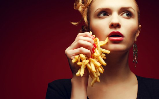 woman-crushing-french-fries.jpg