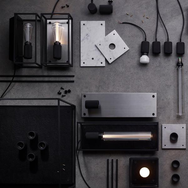 Schwarzes Licht und Rock'n'Roll. - Rauchig und Eisern: Das Londoner Garagenlabel Buster+Punch erschafft Leuchten und dekorative Accessoires maskuliner, düsterer Anmutung. Objekte aus Metallrahmen und feinsten Messing und Bronze-Applikationen kombiniert mit gebürstetem Stahl, Marmor und geflämmtem Granit zaubern eine dunkle und kräftige Atmosphäre in jeden Raum.