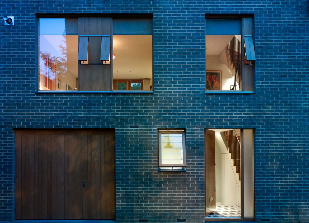 Front facade of Holland Park mews house, at night. A design project for Jill Scholes Interior Design
