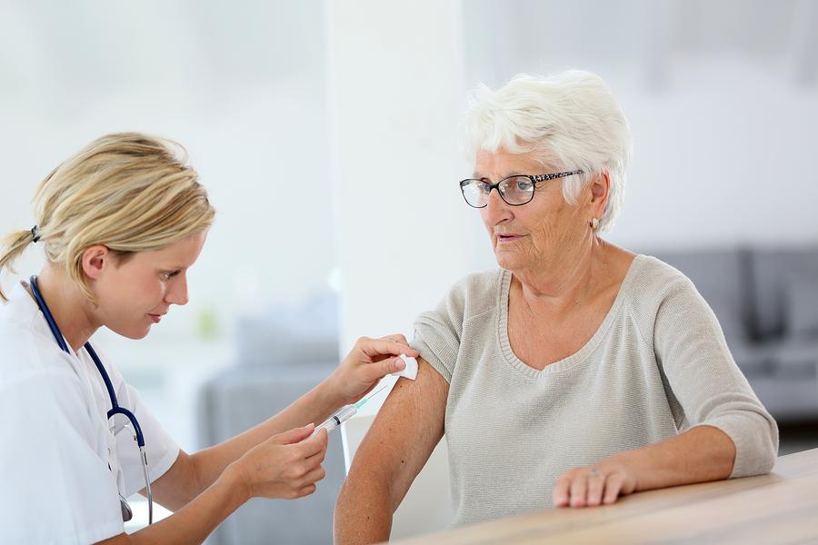 bigstock-Nurse-making-vaccine-injection-67265344.jpg