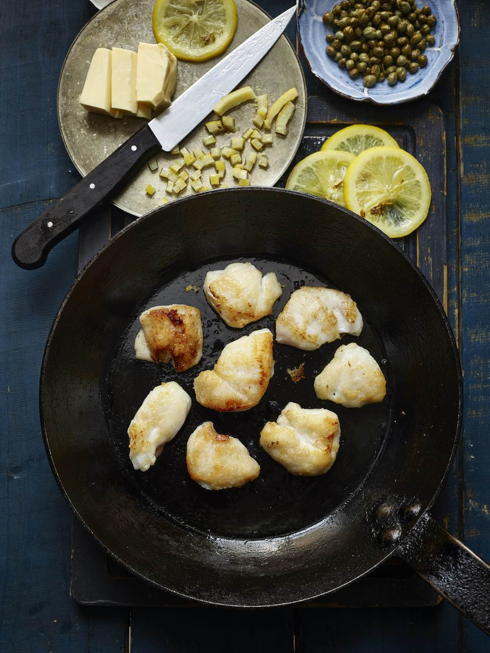 Pan-fried cod cheeks with preserved lemon