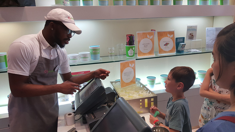 One of our student ordering at Pinkberry with the English Permission Card in hand.