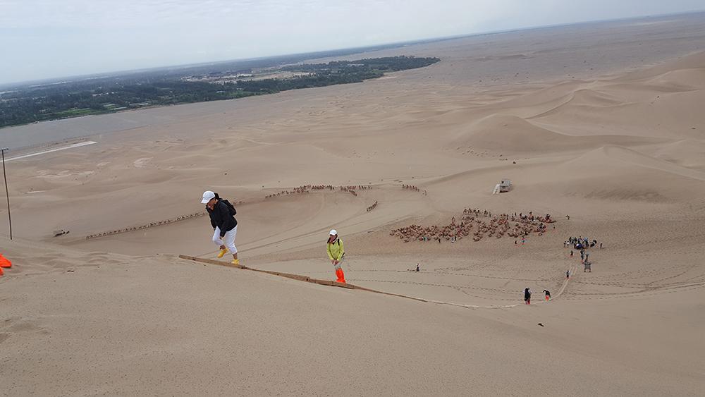 Climbing the sand dunes.