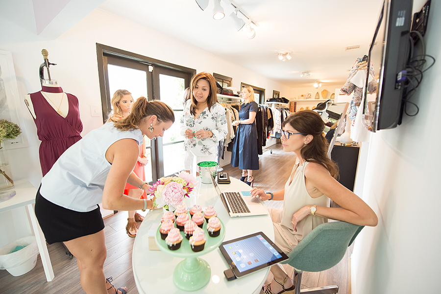 Gina explains to customer Kristi that a portion of her purchase goes to benefit The Will Herndon Research Fund.