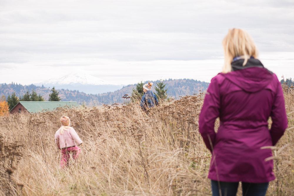 mom watching children in field