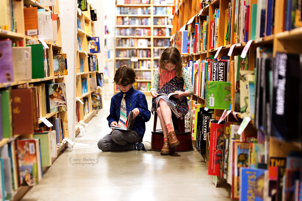 girl and boy Powell's Bookstore aisle