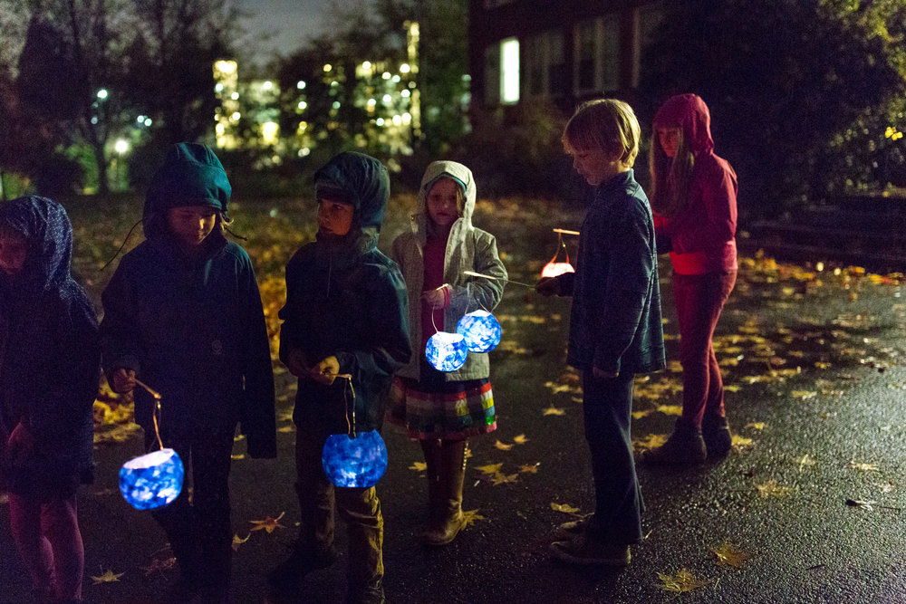 children with handmade paper lanterns