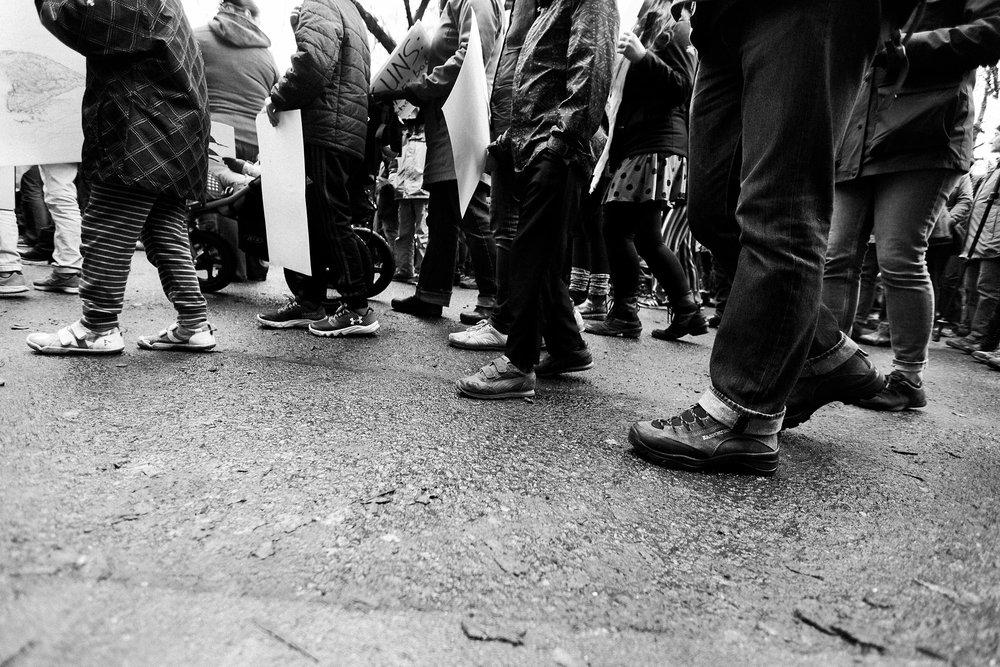 feet of marchers on wet street