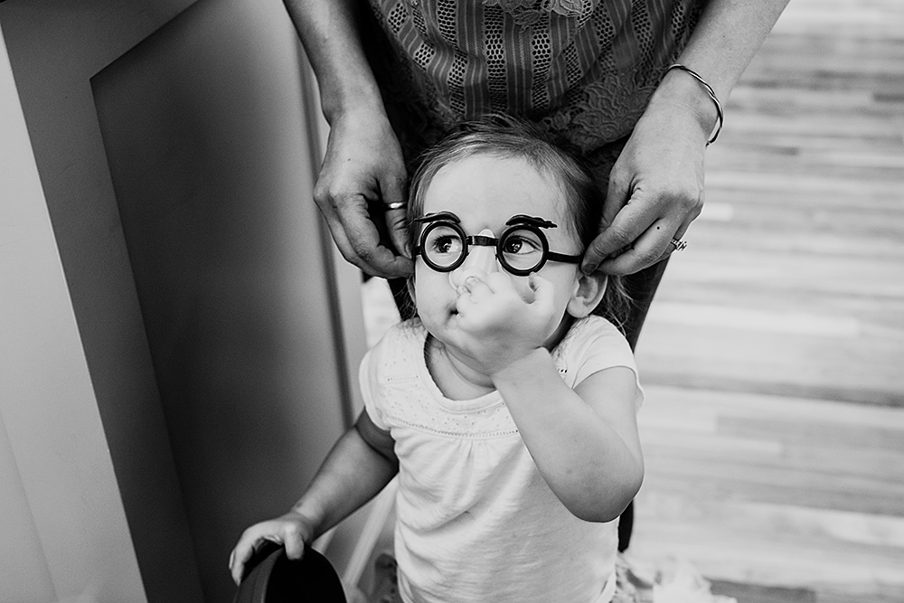 toddler wearing big nose and eyebrow glasses