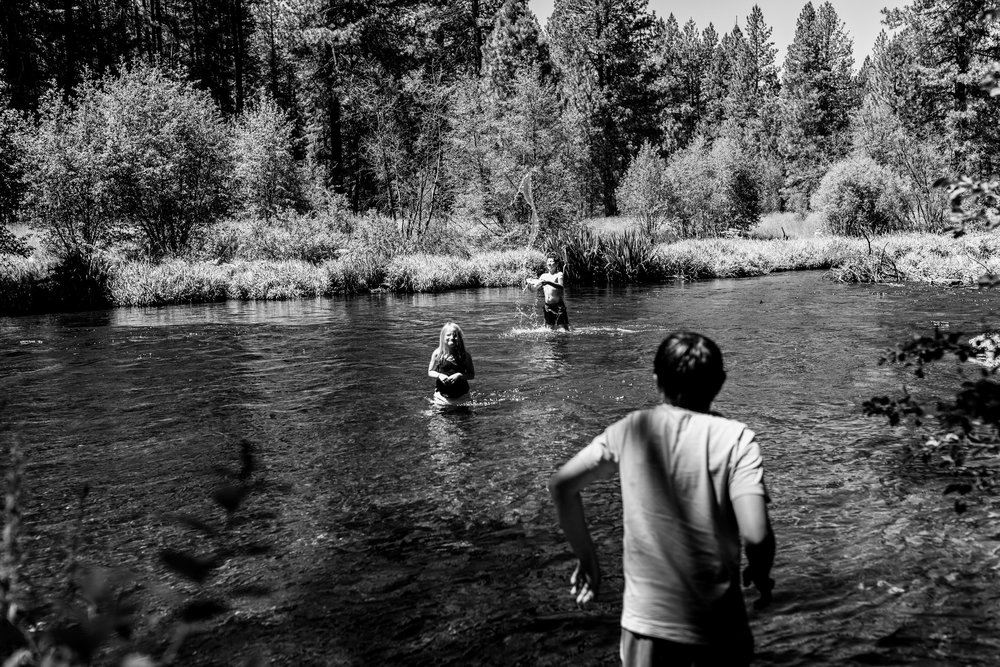 kids in the cold waters of the Metolius River