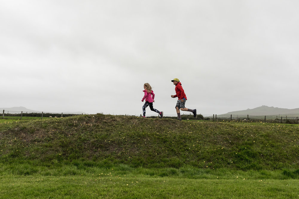 Brother and sister run in Irish pastures