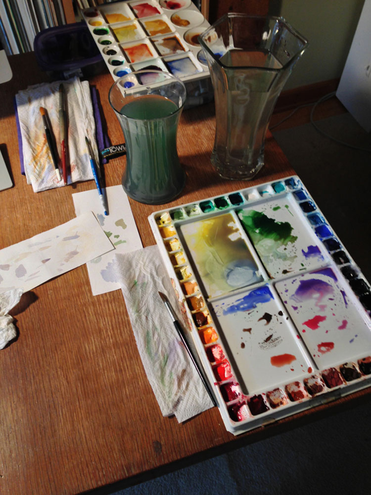 Here's one example of how the palette and brushes described in this post might look in the real world. Notice the paper towel and strips of scrap paper used to test the color and opacity of the watercolors I mix before painting