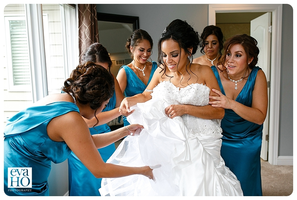Bridesmaids helping the bride get ready to walk down the aisle