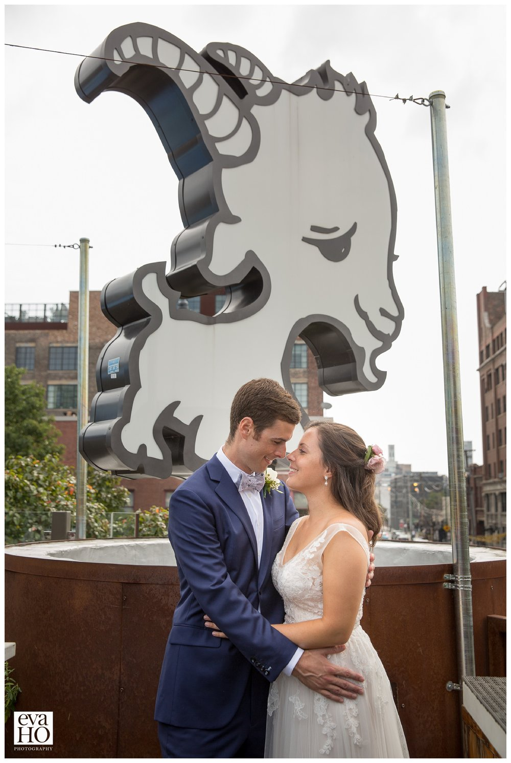 Little Goat Sign behind the Newlyweds