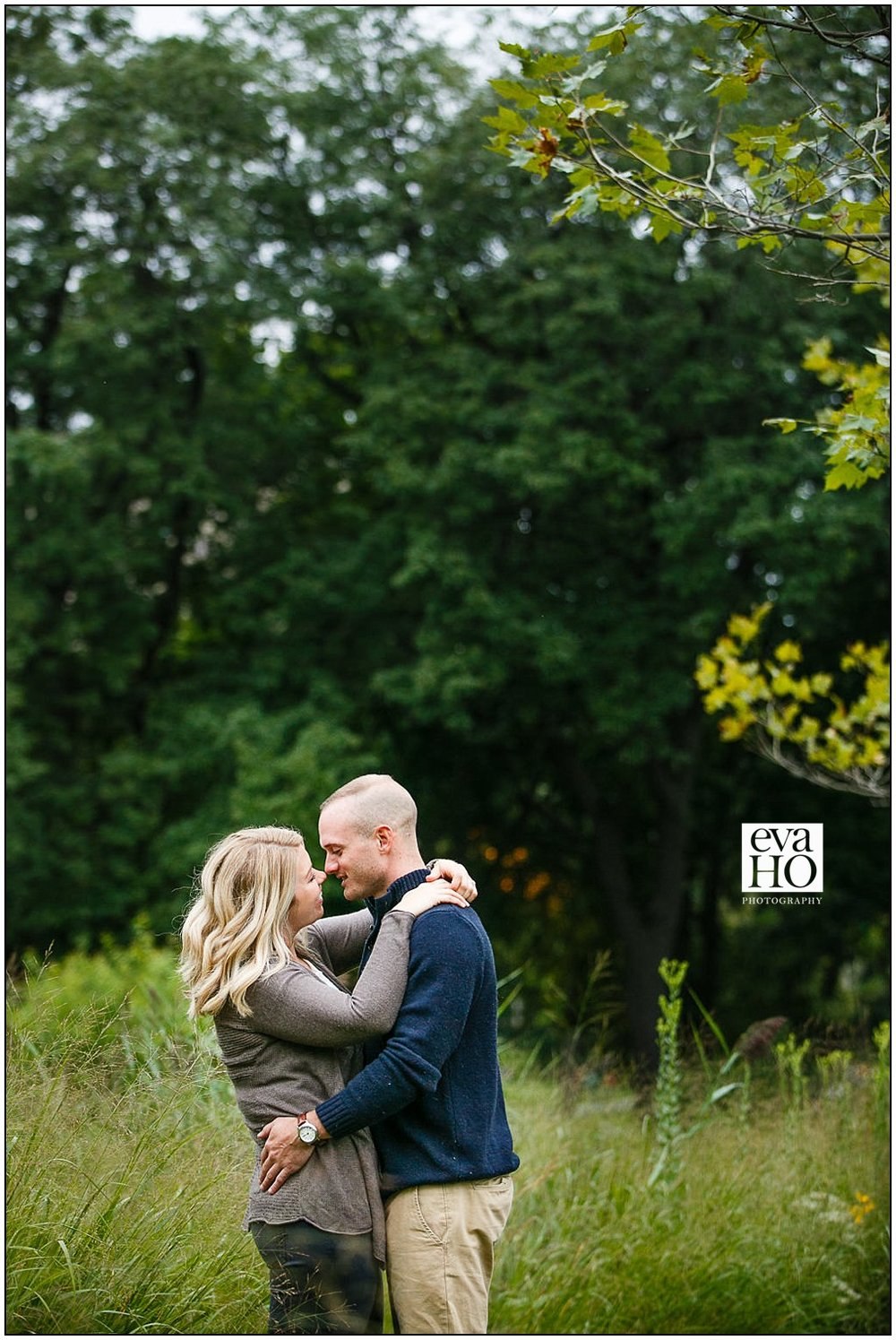 Colleen and Kevin stealing a kiss in the middle of their engagement session in Lincoln Park