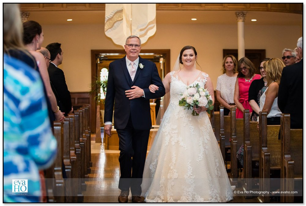 Laura's dad walked her down the aisle.