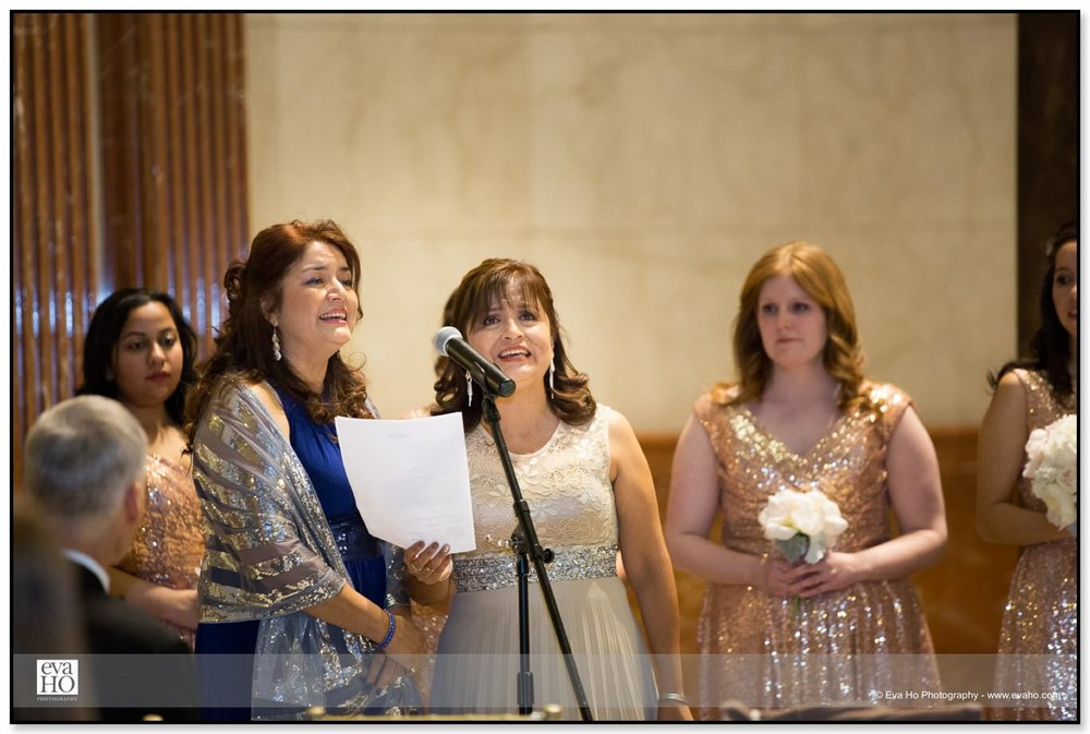 Relatives sing songs during the wedding ceremony