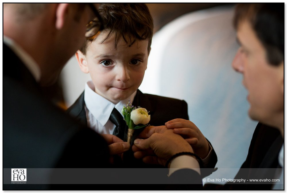 Ring bearer getting flower for lapel at a Chicago wedding