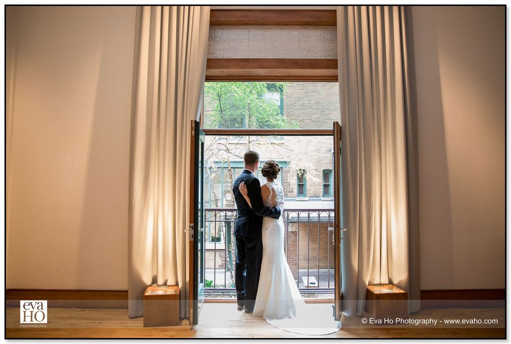 Bride and Groom pose by a window of the Hotel Palomar in downtown Chicago