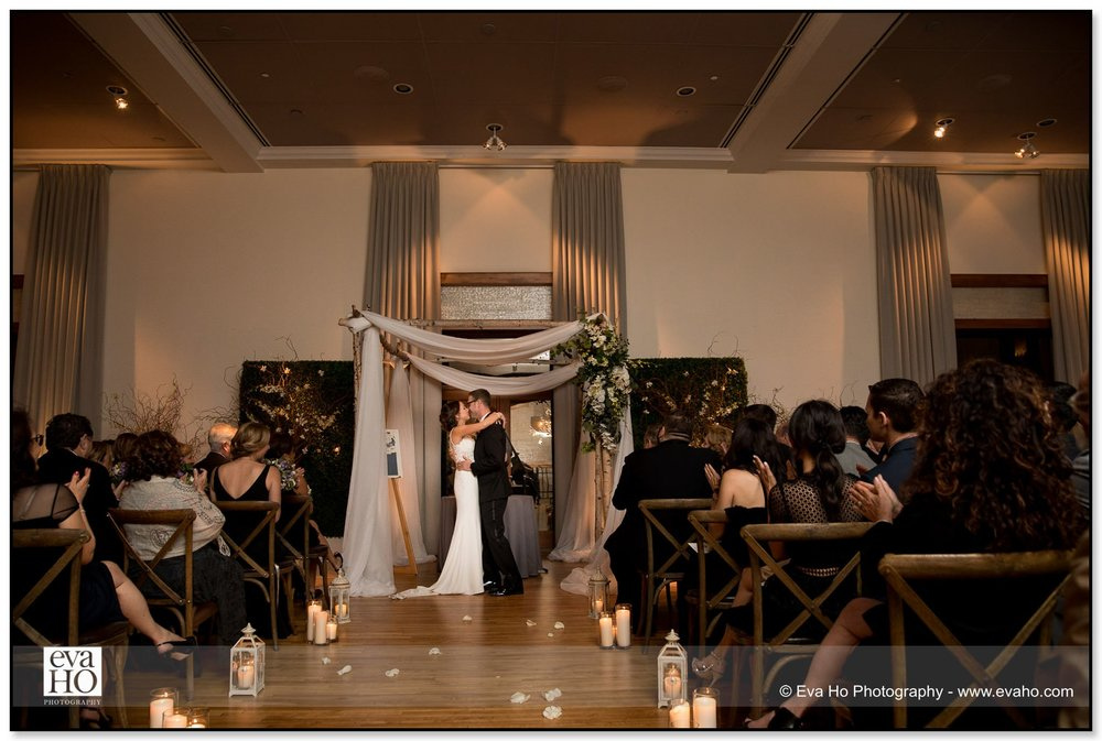 First kiss during a Jewish wedding ceremony at the River North Ivy Room in Chicago