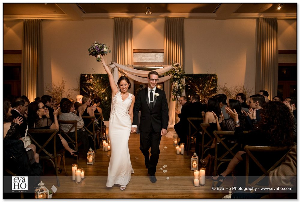 Bride and Groom jubilantly exit the ceremony at a wedding in the Ivy Room