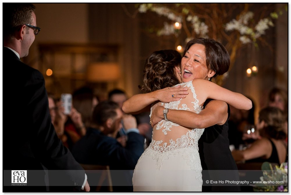 Bride hugs her mother during her wedding reception in Chicago's River North