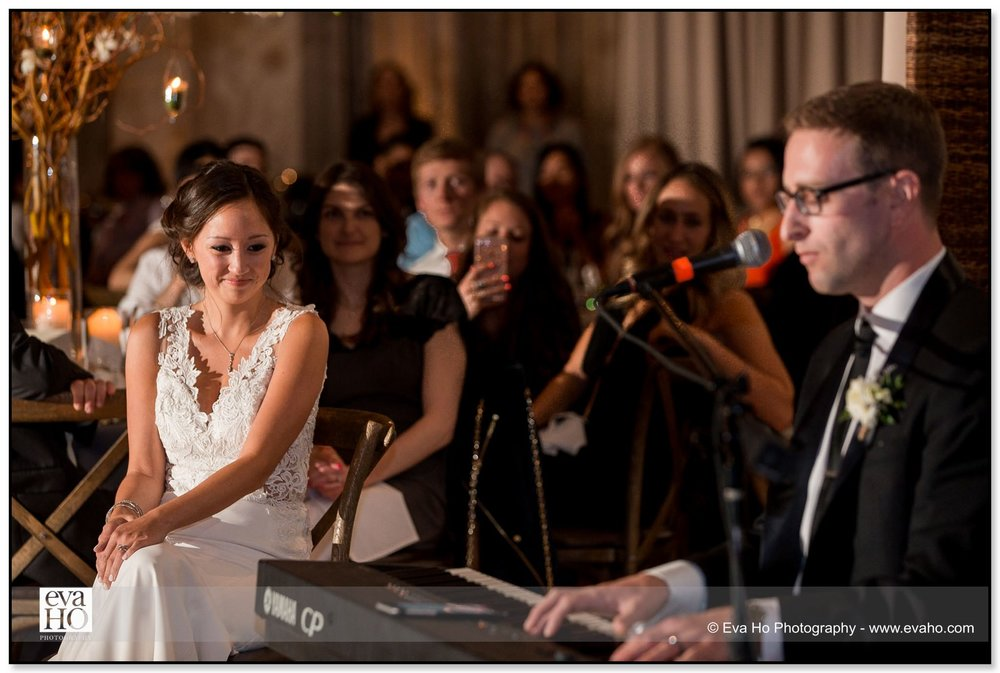 Groom sings and plays the piano to his new bride during this Chicago Jewish wedding