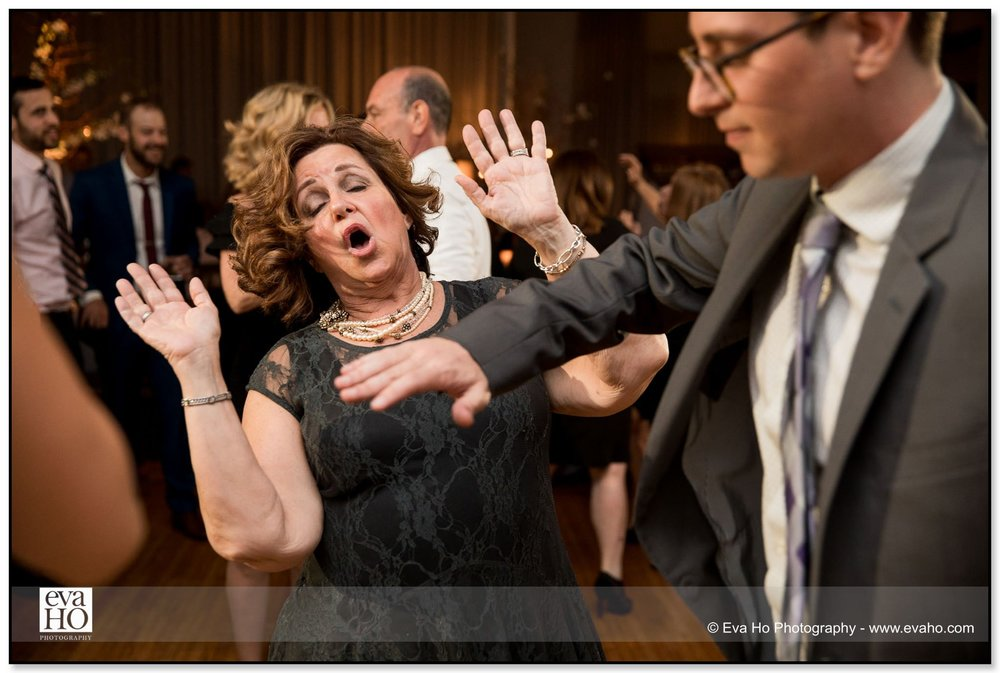 Groom dances with wedding guests at a River North wedding at the Hotel Palomar
