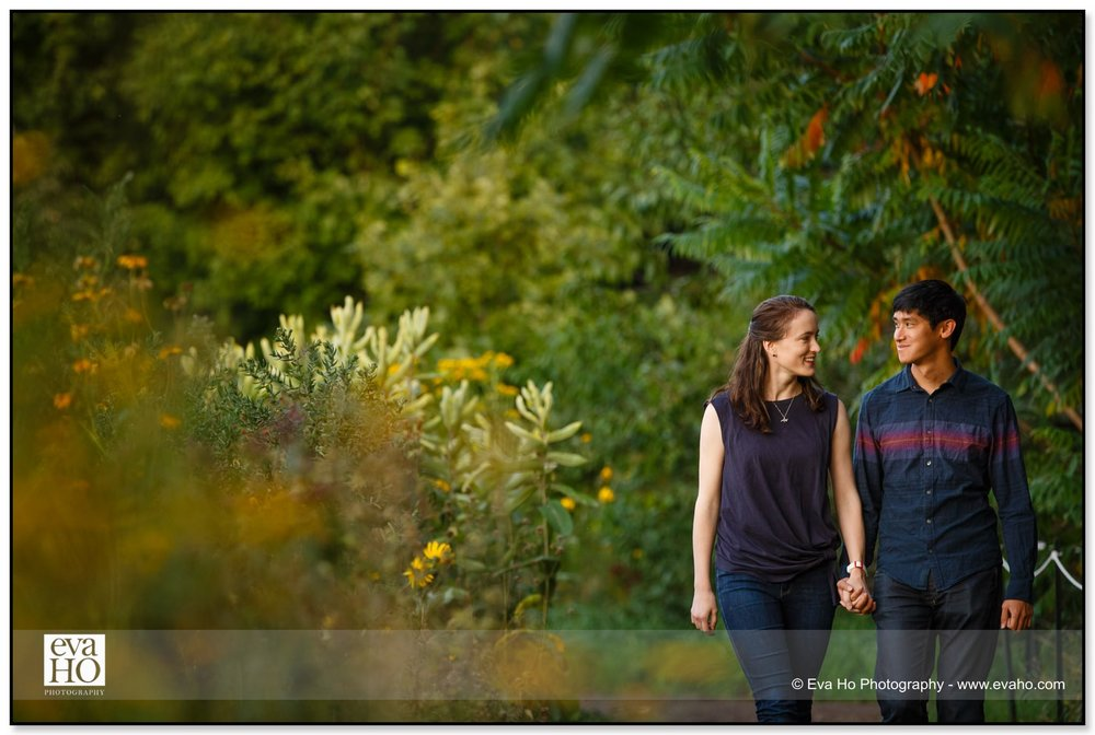 Couple walking during a late summer engagement session in Montrose Harbor