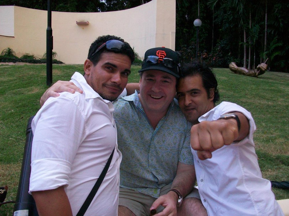 Coppi, my husband, Darius, and a friend on a visit to Cuba.