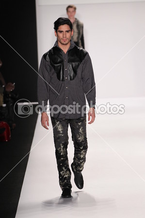 depositphotos_41079741-Model-walks-the-runway-wearing-Mister-Triple-X.jpg