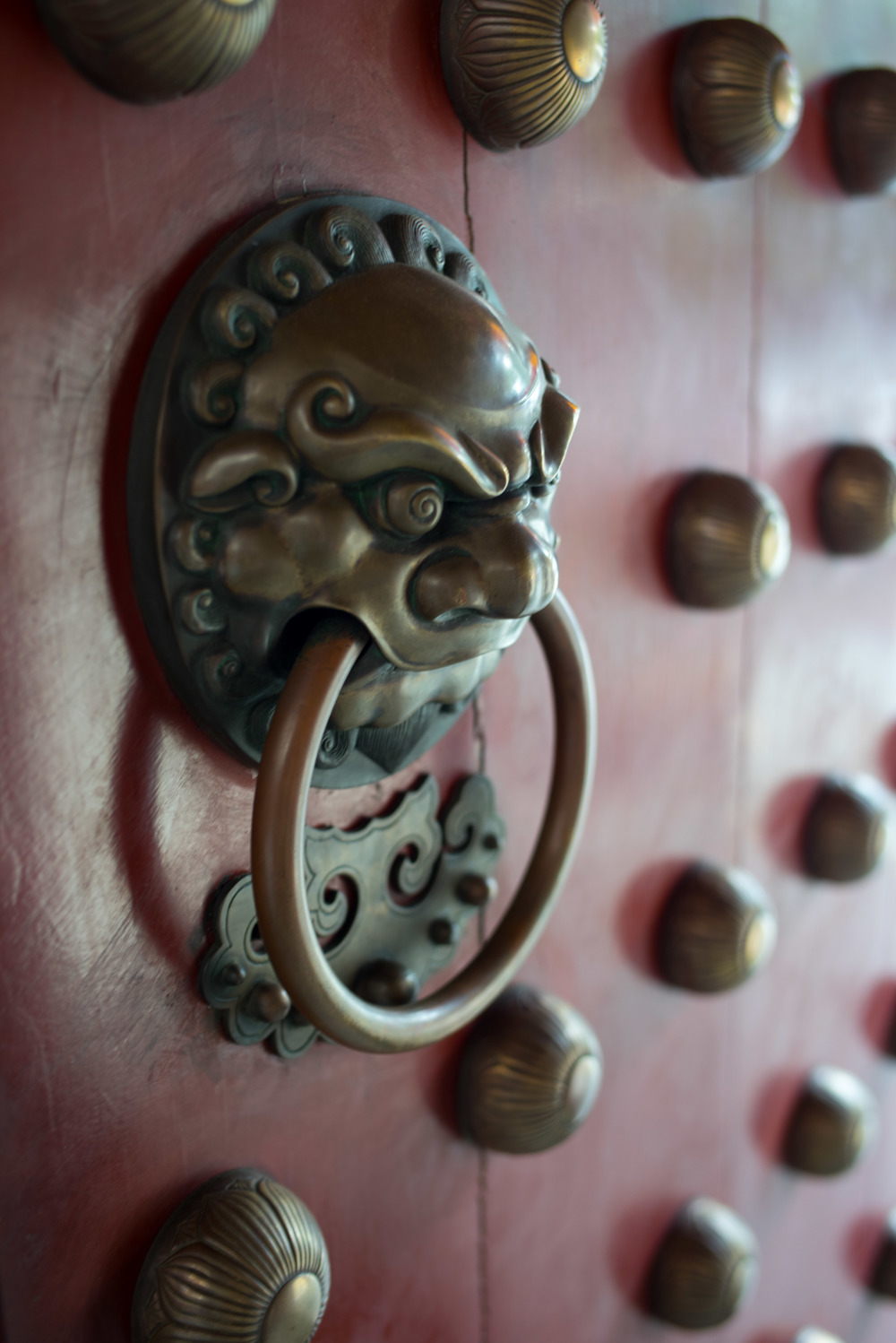 Door knocker to buddhist temple in Singapore