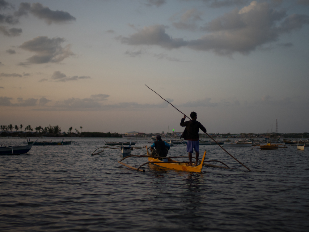 Filipino fishermen go out to fish at sunset
