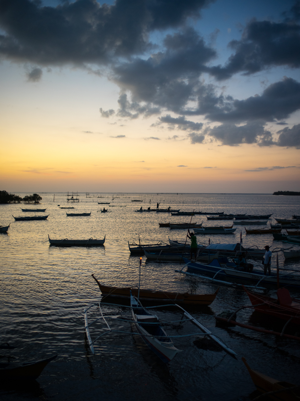 Filipino fishing boat dock at sunset