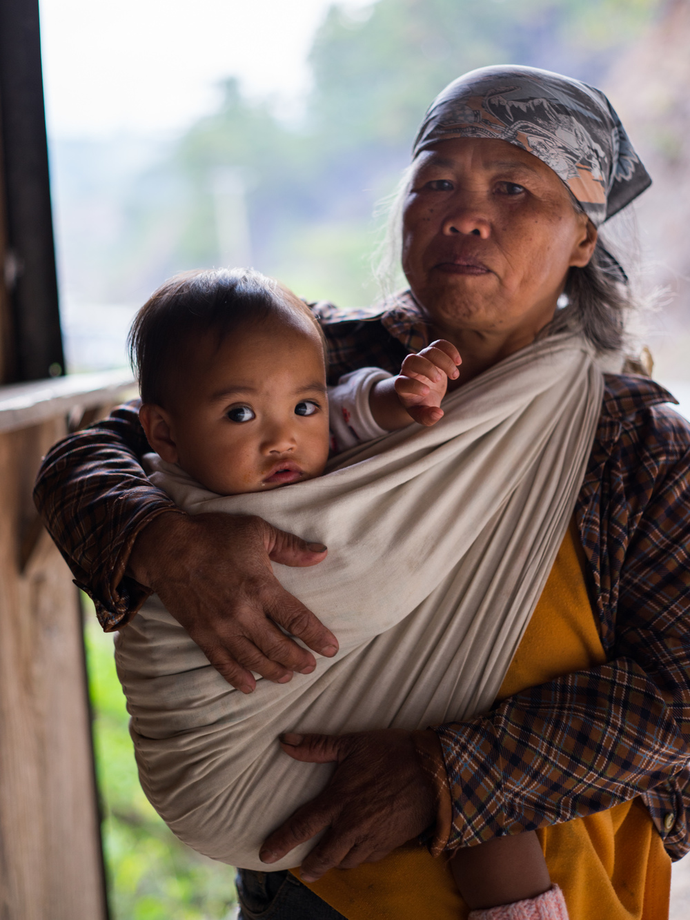 Filipino woman and her grandchild