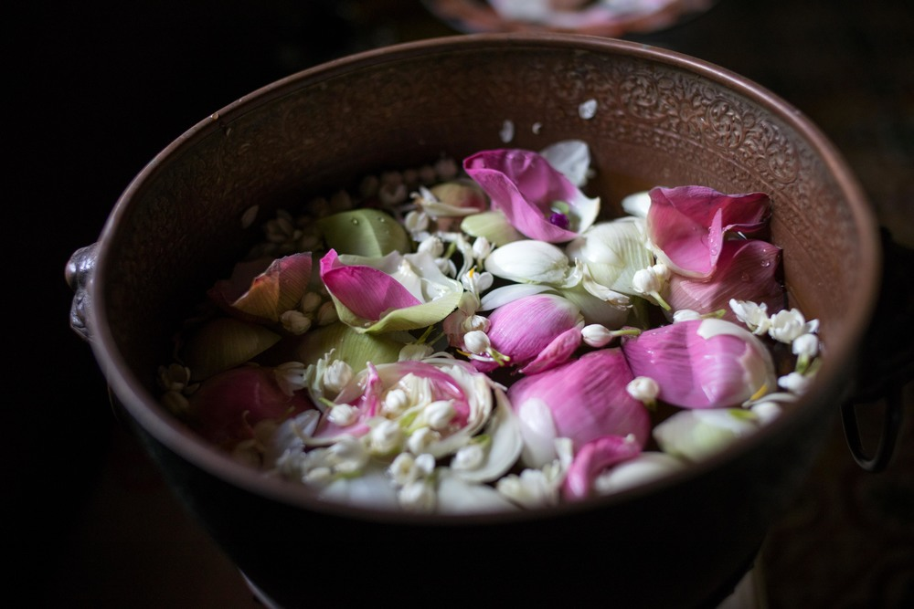 Bowl of flowers in a buddhist temple