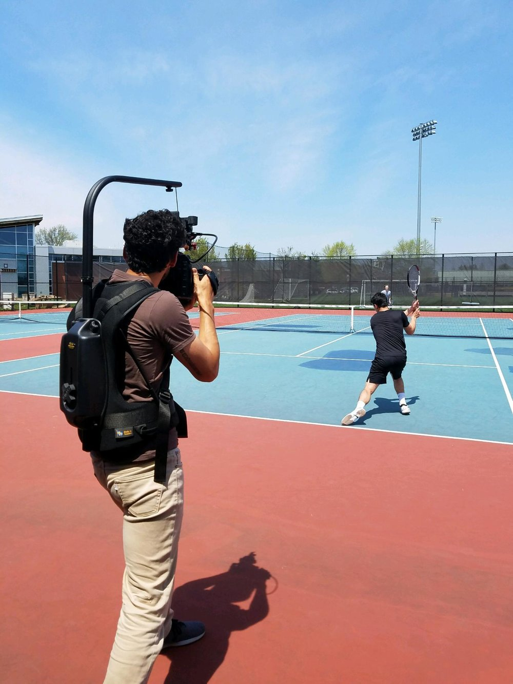 Using my Easyrig Mini and Canon c300 Mark II to shoot b-roll of tennis action shots with Matteo on a 90 degree day. That surface gets hot enough to fry your feet in your shoes.