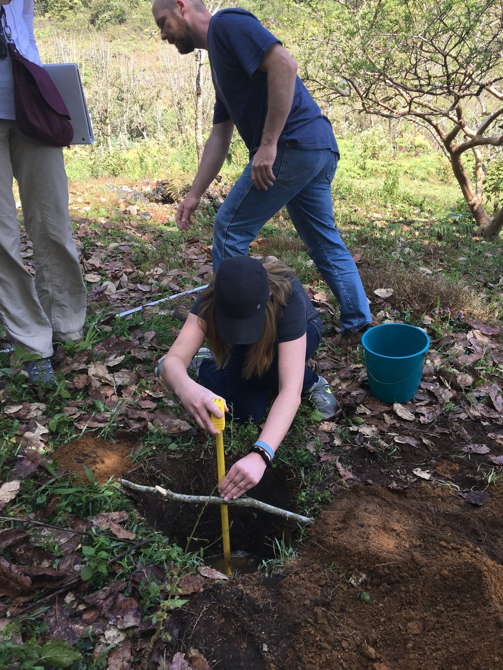 This is me, measuring water dropping in a test hole to come up with the sanitary percolation rate (in order to size the septic tank and soak pits).