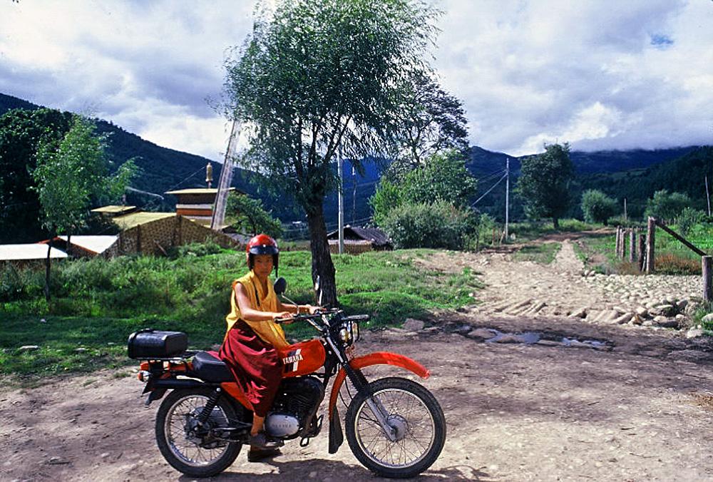 Bhutan.Bumthang.YoungMonkOnBike.jpg