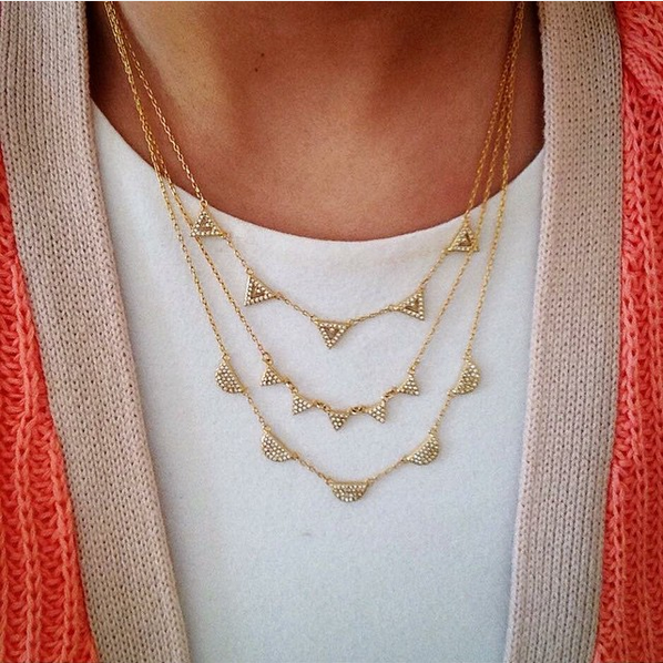 Add some more versatility in your life with the Pavé Chevron Necklace in gold.