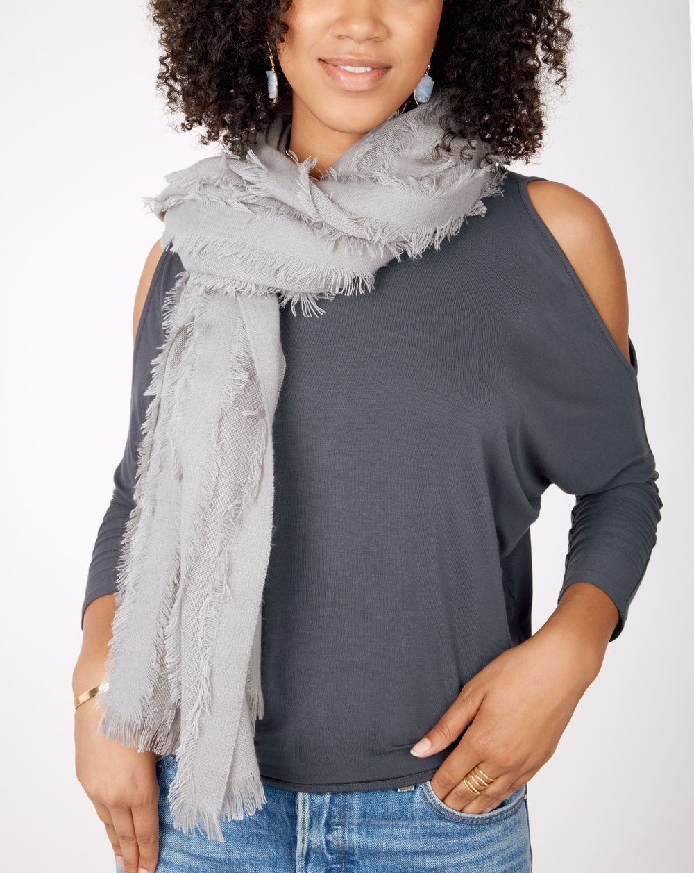 1. The St. Germain Scarf - It's starting to get cooler which means we can finally reach for our new favorite scarf, the St. Germain! With a subdued gray color and baby fringe, you can't go wrong. As the softest scarf we've ever felt, this is one fall staple we won't be without.