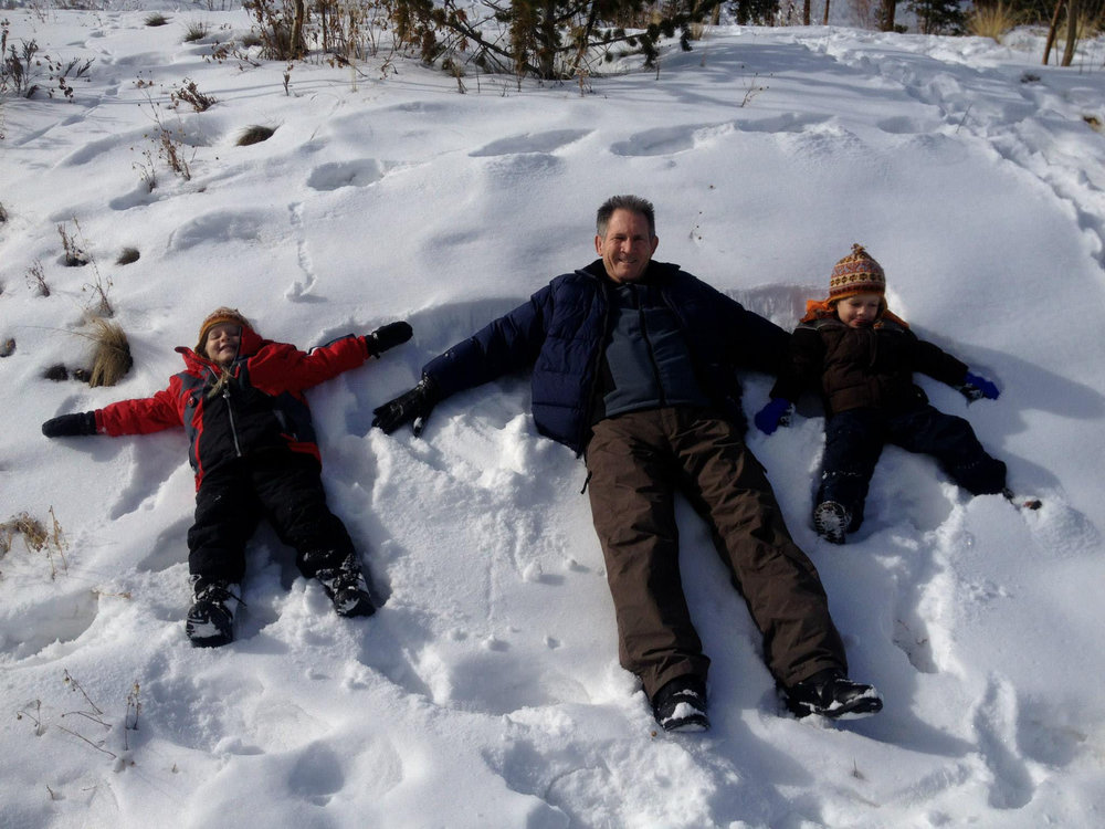 Dan snow fun with grandkids.jpg