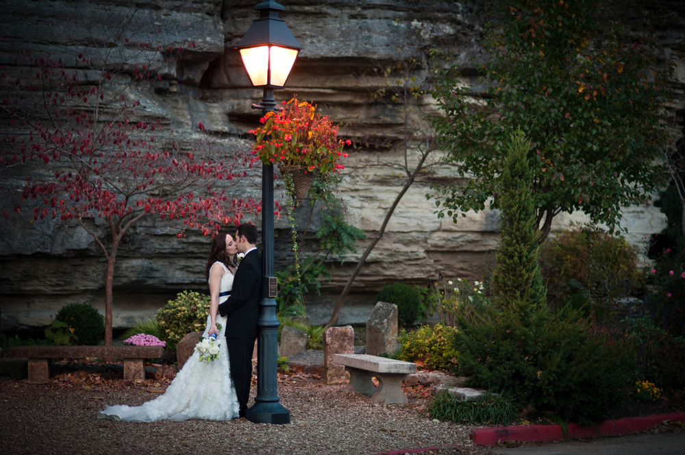 Bride and Groom kissing under street lamp