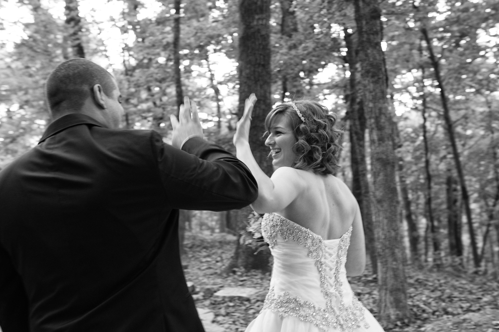 Bride and Groom high five after ceremony