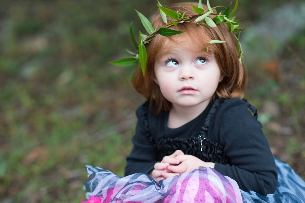 Little girl with grass halo wreath