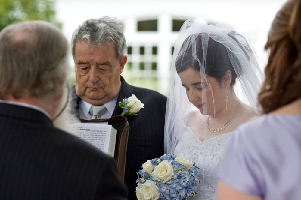 Father gives bride away, prayer