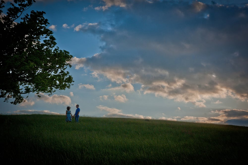 Couple at sunset near a big tree