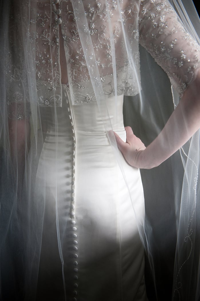 Bride dress back detail in window light
